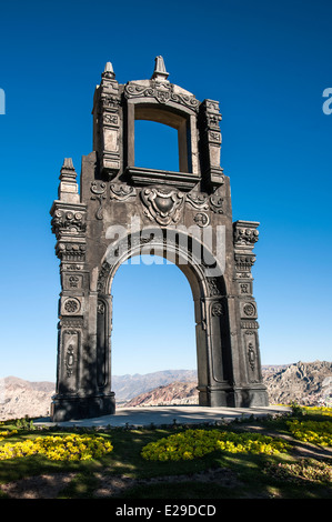 Ancient Ornate arch on top of Cerro Quilli, La Paz from above, with Nevado Illamani in the distance. Bolivia - Stock Photo