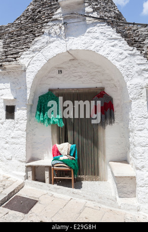 House entrance, porch and door, in traditional conical roofed whitewashed trulli building, Alberobello, Puglia, - Stock Photo