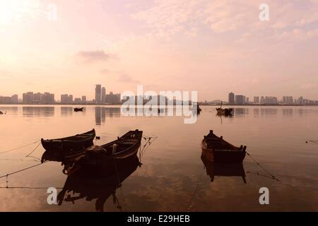 Qingdao, China's Shandong province. 17th June, 2014. Boats are moored at the Tangdao Bay, a beach park in Qingdao - Stock Photo