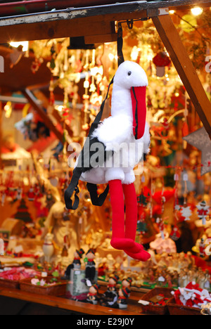 Cuddly toy of the emblematic Alsatian ciconia in the Christmas market of Colmar, Alsace, France - Stock Photo