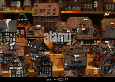 Miniatures of traditional Alsatian houses for sale in a Colmar Christmas market stall, Alsace, France - Stock Photo