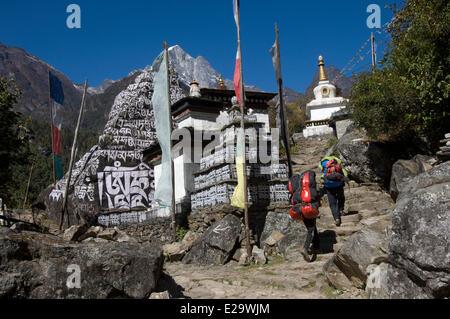 Nepal, Sagarmatha Zone, Khumbu Region, approach walk amidst stupas carved with mantras - Stock Photo