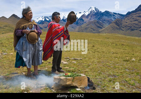Bolivia, Cordillera Apolobamba, kallawaya ceremony of offerings to the Pachamama, or pago (payment), on a pasture - Stock Photo