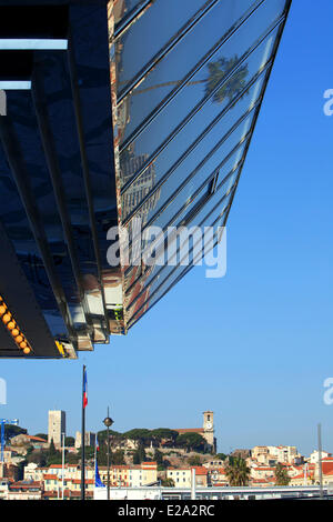 France, Alpes Maritimes, Cannes, Palais des Festivals, the casino, Le Suquet District in the background - Stock Photo