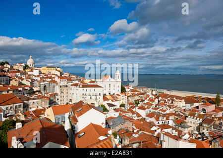 Portugal, Lisbon, view over the rooftops of the Alfama district and the Tage river from the terrace of Largo das - Stock Photo