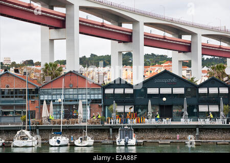 Portugal, Lisbon, the district of the Docas, the ancient docks of Santo Amaro under the 25 de Abril Bridge is the - Stock Photo