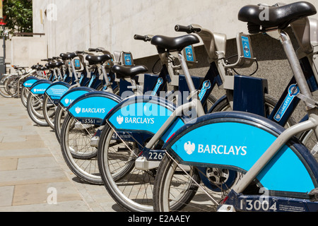 Barclays Cycle Hire,cycle hire scheme, aka Boris bikes lined up at docking station, London, England, UK - Stock Photo