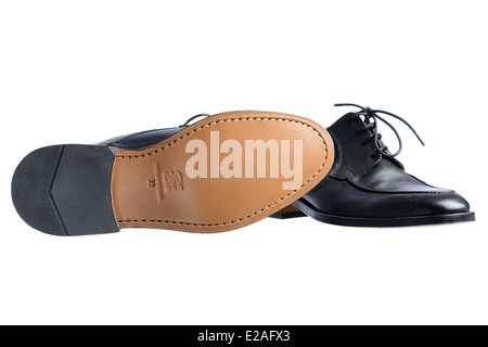 One pair of black leather shoes with 'made in Portugal' engraved on the sole - Stock Photo