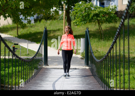 Woman power walking in a park - Stock Photo