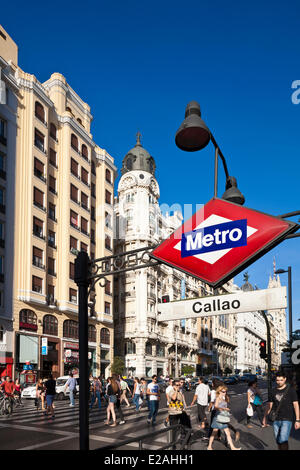 Spain, Madrid, Gran Via, downtown main artery with buildings from the early 20th century and the Callao metro station - Stock Photo