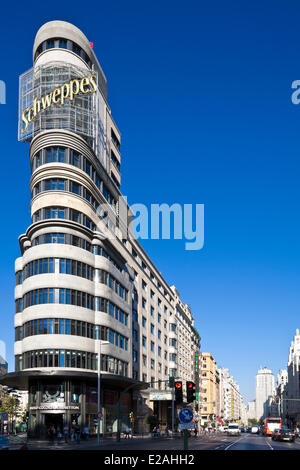 Spain, Madrid, Gran Via, downtown main artery, Carrion edifice designed by architects Luis Martinez-Feduchi and - Stock Photo