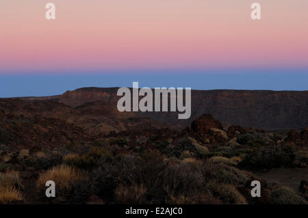 Spain, Canary Islands, Tenerife, Teide National Park listed as World Heritage by UNESCO, Teide volcano, sunset over - Stock Photo