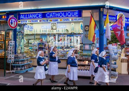 France, Hautes Pyrenees, Lourdes, religious souvenir shop - Stock Photo