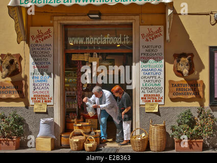 Italy, Umbria, Norcia, shop selling local produce, hams, saussisses, dried fruits, dried beans - Stock Photo