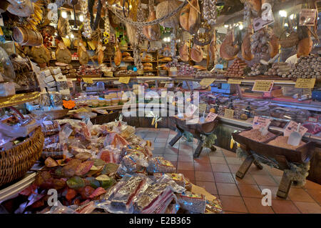 Italy, Umbria, Norcia, shop selling local produce, hams, saussisses, dried fruits, dried beans, dried mushrooms - Stock Photo