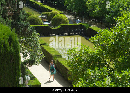 Spain, Andalucia, Seville, Alcazar of Seville classified as World Heritage by UNESCO, painter and woman walking - Stock Photo