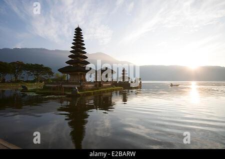 Indonesia, Bali, near Bedugul, temple Pura Ulun Danu on Bratan lake at sunrise and its reflection on the lake - Stock Photo