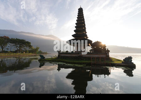 Indonesia, Bali, near Bedugul, temple Pura Ulun Danu on Bratan lake at sunrise and its reflection on the lake - Stock Photo