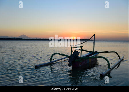 Indonesia, Lombok, Gili archipelago, sunset in Gili Air and the volcano Gunung Agung in the background - Stock Photo