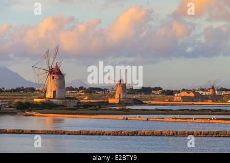 Old windmills in Marsala salts - Stock Photo