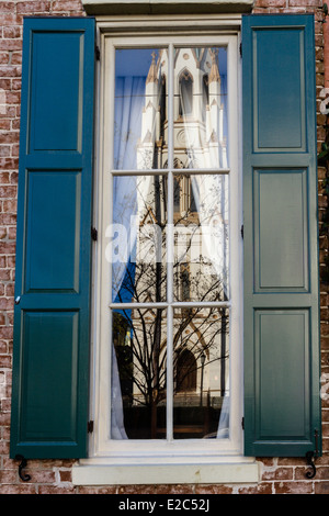 The Cathedral of St. John the Baptist in a window reflection, Savannah, Georgia - Stock Photo
