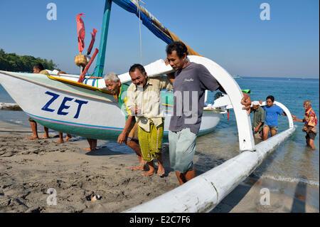 Indonesia, Lombok, Senggigi searesort, return from fishing - Stock Photo