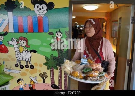 Indonesia, Lombok, saleswoman on the ferry to Sumbawa - Stock Photo