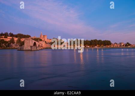 France, Vaucluse, Avignon, Rhone river with Palais des Papes and Pont St Benezet listed as World Heritage by UNESCO - Stock Photo