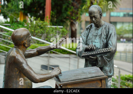 Singapore, sculptures at Boat Quay depict activities carried out on banks of Singapore River in 19th century early - Stock Photo