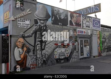Germany, Berlin, East Side Gallery is the longest piece of the Berlin Wall still standing near the Oberbaumbrucke, it is covered with graffiti done by nearly 120 artists
