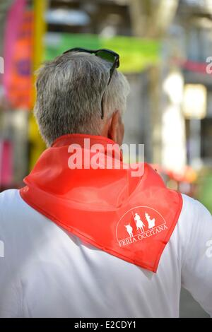 France, Herault, Beziers, annual feria in the streets of the city, man of back wearing a red scarf around the neck - Stock Photo