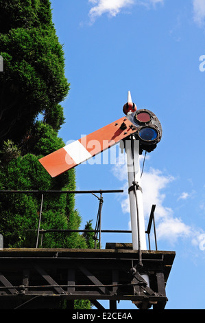 Semaphore signal of the bracket design showing the lower quadrant home all clear at the railway station, Hampton - Stock Photo