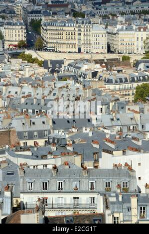 France, Paris, buildings rooftops of the fifth arrondissement and building facades on the Ile Saint-Louis - Stock Photo