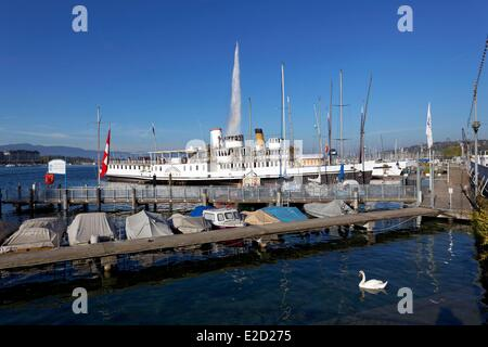 Switzerland Geneva Lake Geneva English Garden steamboat dock fountain in the background - Stock Photo