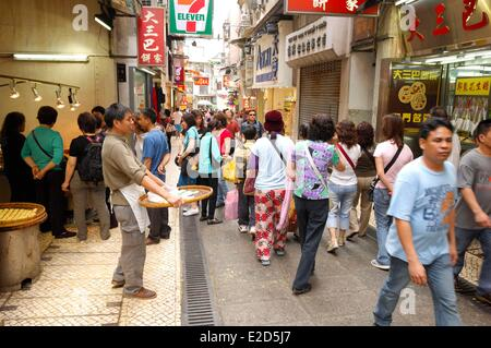 China Macau walkers in the pedestrian streets of the old town - Stock Photo