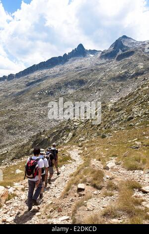 France Hautes Pyrenees Aragnouet hiker on a trail to the peak of Neouvielle - Stock Photo