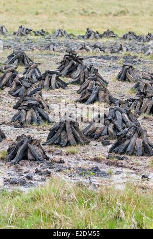 Ireland Galway County Maam Cross Connemara drying peat - Stock Photo