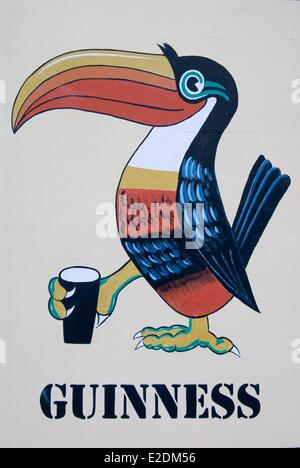 Ireland Galway County Maam Cross Connemara painted advertising for the Guinness beer toucan holding a pint - Stock Photo