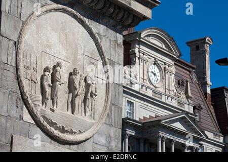 Canada Quebec province Montreal Old Montreal the City Hall and in the foreground bas-relief on the base of the statue - Stock Photo