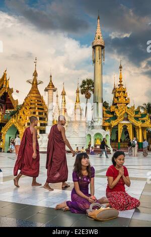 Myanmar (Burma) Yangon division Yangon district of Kandawgyi Shwedagon Pagoda buddhist praying - Stock Photo