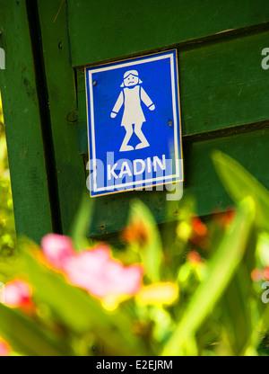 Humorous Ladies lavatory sign. - Stock Photo