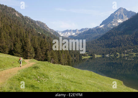 France, Hautes Pyrenees, Aragnouet, hiker on the GR10 footpath near the l'Oule lake - Stock Photo