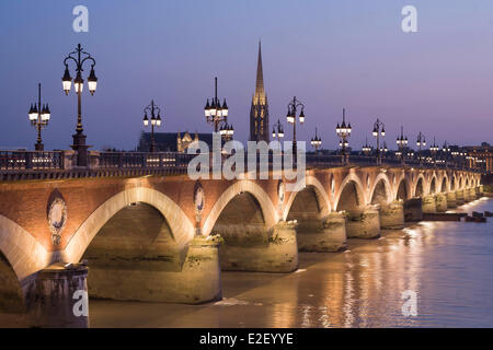 France Gironde  Bordeaux the Pont de Pierre bridge on the Garonne river and Saint Michel cathedral listed as World - Stock Photo
