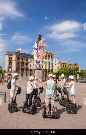 Spain, Catalonia, Barcelona, Port Vell, sightseeing in Segway, sculpture Cap de Barcelona (1992) - Stock Photo