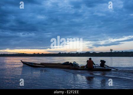 Peru, Madre de Dios, Amazon, Puerto Maldonado, canoe at sunset on the Rio Madre de Dios river - Stock Photo