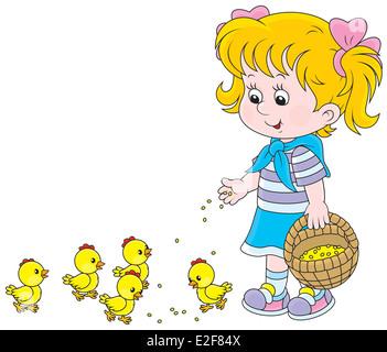 Little girl feeding small yellow chickens - Stock Photo