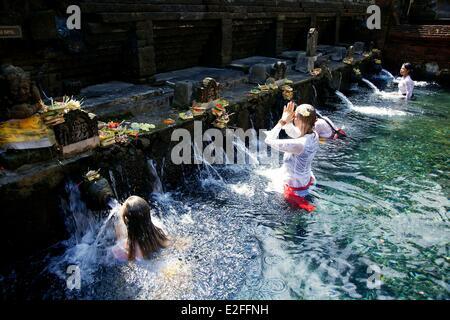 Indonesia, Bali, near Ubud, Pura Tirta Empul Temple, bath in Tampaksiring sacred spring - Stock Photo