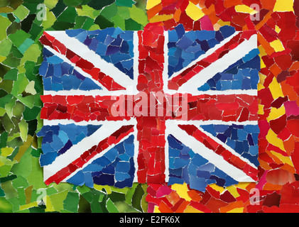UK national flag made from many pieces of torn paper on green and red background - Stock Photo