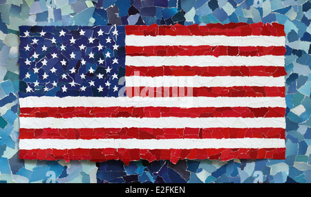 US national flag made from many pieces of torn paper on sky blue background - Stock Photo