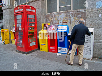Chinese newspaper stand, Chinatown, West End, City of Westminster, London, England, United Kingdom - Stock Photo